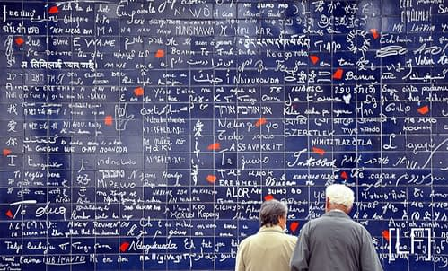 An-elderly-couple-sharing-a-beautiful-moment-at-the-wall-of-love-in-Paris